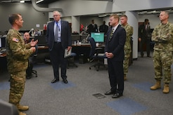 U.S. Army Col. Christopher Pflanz, Training and Doctrine Command G-27 Operational Environment Training Support Center director, left, briefs Acting Secretary of the Army Ryan McCarthy, third from left, during a visit to Joint Base Langley-Eustis, Va., Aug. 10, 2017. During his visit, McCarthy was familiarized with the scope and scale of TRADOC's mission, including Army growth requirements and future battle capabilities. (Photo blurred for security purposes)(U.S. Air Force photo/ Tech. Sgt. Katie Gar Ward)