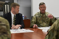 U.S. Army Gen. David G. Perkins, commander of Training and Doctrine Command, right, briefs Acting Secretary of the Army Ryan McCarthy, left, during a visit to Joint Base Langley-Eustis, Va., Aug. 10, 2017. During his brief, Perkins discussed TRADOC and the Army Capabilities Integration Center's role in building the future Army. (U.S. Air Force photo/Tech. Sgt. Katie Gar Ward)