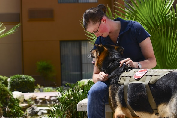 Staff Sgt. Amanda Cubbage, a 355th Security Forces Squadron member, reunites with her recently retired military working dog, Rick, in Tucson, Ariz., Aug. 8, 2017. Cubbage worked with Rick while she served as a MWD handler at Osan Air Base, South Korea. (U.S. Air Force photo/ Airman 1st Class Michael X. Beyer)