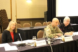 Noreen Walsh, Regional Director, Mountain-Prairie Region, U.S. Fish & Wildlife Service (left), Maj. Gen. Scott A. Spellmon, Commander, Northwestern Division, U.S. Army Corps of Engineers (center), and MRRIC Chair Gail Bingham (right) seated at a table.