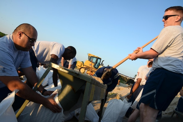 """436th Civil Engineer Squadron Airmen fill sandbags for the upcoming 2017 Dover Air Force Base Open House """"Thunder Over Dover"""" Aug. 10, 2017, on Dover AFB, Del. Each section of the 436th CES has been tasked with different responsibilities for preparation during the open house. (U.S. Air Force photo/Tech. Sgt. Matt Davis)"""