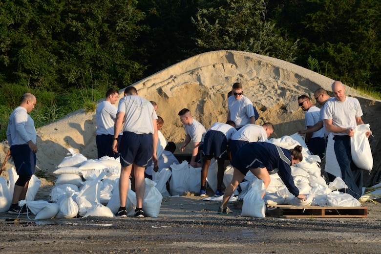 "436th Civil Engineer Squadron Airmen fill sandbags for the upcoming 2017 Dover Air Force Base Open House ""Thunder Over Dover"" Aug. 10, 2017, on Dover AFB, Del."