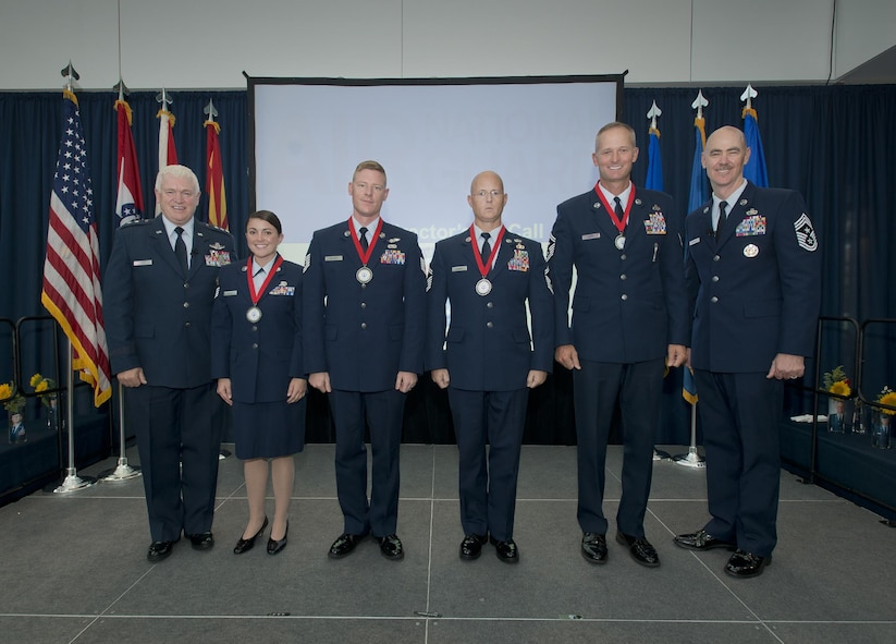 Lt. Gen. L. Scott Rice, director of the Air National Guard and Chief Master Sgt. Ronald C. Anderson, the command chief master sergeant of the ANG, pose for a photo with the ANG Outstanding Airmen of the Year during the Focus on the Force Week All Call. The OAY winners are (left to right) Staff Sgt. Lacey K. Miller, Airman of the Year; Tech. Sgt. Sgt. Jason D. Selberg, Non-Commissioned Officer of the Year; Senior Master Sgt. Thomas J. DuMont, Senior Non-Commissioned Officer of the Year; and Senior Master Sgt. Jason L. Handa, First Sergeant of the Year. (U.S. Air National Guard photo by Master. Sgt. Marvin R. Preston)