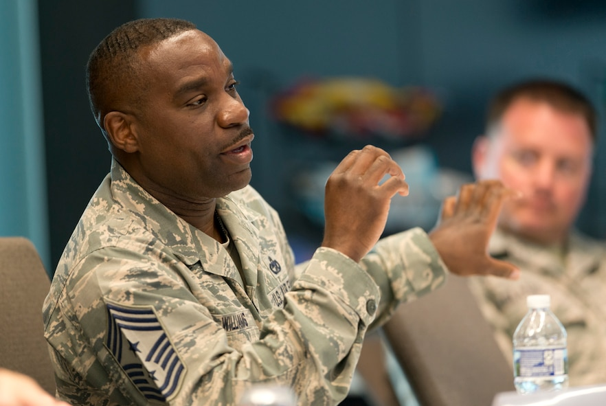 Chief Master Sgt. Maurice Williams, Enlisted Field Advisory Council chairman, poses a question during a panel discussion with the Air National Guard's 2016 Outstanding Airmen of the Year at the ANG Readiness Center on Joint Base Andrews, Md., August 9, 2017. Focus on the Force Week is a series of events designed to renew Airmen's commitment to the profession of arms and celebrate the successes of the enlisted corps. (U.S. Air National Guard photo/Master Sgt. Marvin Preston)