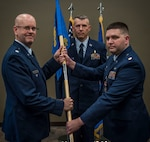 Lt. Col. Wayne Johnson, deputy commander for the 932nd Mission Support Group receives the Logistic Readiness Flight guidon from Maj. Christopher Kaighen Aug. 5, 2017, Scott Air Force Base, Illinois during a change of command ceremony.  Kaighen relinquished command of the 932nd LRF and will take on a new role as 22 AF/A4R Chief, Logistics Readiness Division. (U.S. Air Force photo by Tech. Sgt. Christopher Parr)