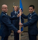 Lt. Col. Wayne Johnson, deputy commander for the 932nd Mission Support Group hands over command of the Logistic Readiness Flight to 1st. Lt. James Harbison Aug. 5, 2017, Scott Air Force Base, Illinois during a change of command ceremony. (U.S. Air Force photo by Tech. Sgt. Christopher Parr)