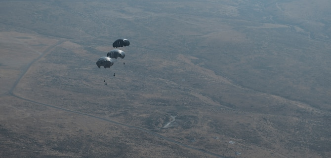 U.S. Airmen assigned to the 517th Airlift Squadron from Joint Base Elmendorf-Richardson, Alaska, conduct an air drop from a C-17 Globemaster III cargo aircraft in support of Exercise Mobility Guardian at Joint Base Lewis-McChord, Wash., Aug. 10, 2017. Mobility Guardian is Air Mobility Command's premier exercise, providing an opportunity for mobility forces to train with joint and international partners in airlift, air refueling, aeromedical evacuation and mobility support. (U.S. Air Force Photo by Tech. Sgt. Gregory Brook)