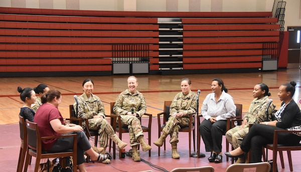 Far East District commander Col. Teresa Schlosser (center), and FED employees Jisun Kang (2nd from left), Emam Sundquist (3rd from right),  Mia Dukuly (right) sit amongst participants of the 2017 Women's Equality Day panel discussion held at Sitman Fitness Center, Camp Humphreys, South Korea, Aug. 10, 2017.