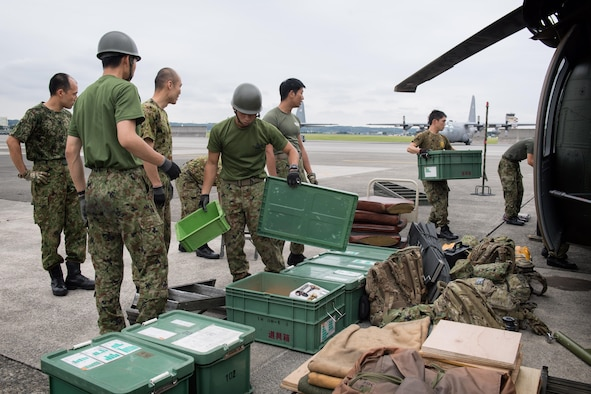 Japan Ground Self-Defense Force members assigned to the 102nd Aviation, at Camp Kizarazu, begin unloading equipment during a C-17 load engagement, August 3, 2017, at Yokota Air Base, Japan. The training highlighted Yokota's support and interoperability with the JGSDF. (U.S. Air Force photo by Airman 1st Class Juan Torres)