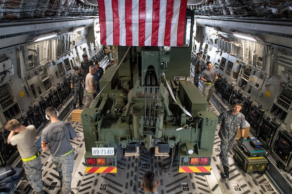 U.S. Air Force Airmen, and Japan Self-Defense Force members, load, tie down and inspect a vehicle during a C-17 load engagement, August 4, 2017, at Yokota Air Base, Japan. The training highlighted Pacific Air Force's interoperability with the JGSDF. (U.S. Air Force photo by Airman 1st Class Juan Torres)