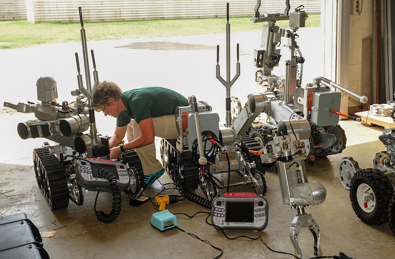 Kimberly Tipton, Remotec instructor, troubleshoots an Air Force Medium Sized Robot at Kunsan Air Base, Republic of Korea, Aug. 10, 2017. Tipton was sent here to teach a week-long class training Explosive Ordinance Disposal Airmen how to perform general repairs on the robots that they use for missions. (U.S. Air Force photo by Senior Airman Colby L. Hardin)