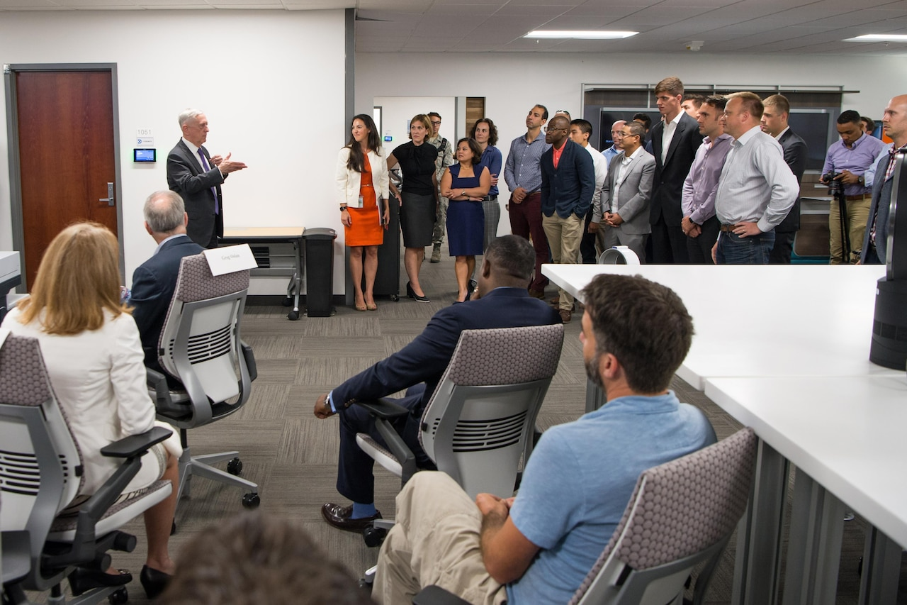 Defense Secretary Jim Mattis speaks with members of the Defense Innovation Unit Experimental