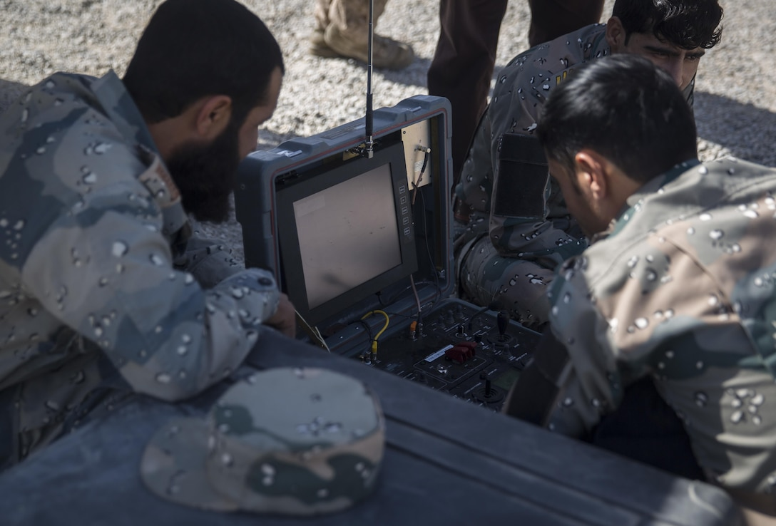 Engineers with the 505th Zone National Police pull a notional improvised explosive device out of the ground utilizing the Talon at Bost Airfield, Afghanistan, June 8, 2017. During the class, the engineers focused on techniques to detect, uncover and destroy IEDs. This training, given by a Marine advisor with Task Force Southwest, aided them in a real-life operational environment during Maiwand 4. (U.S. Marine Corps photo by Sgt. Justin T. Updegraff)