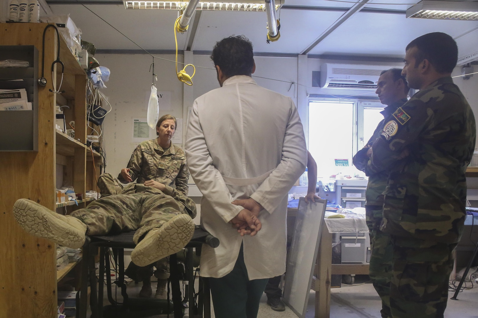 A U.S. Army soldier with 2nd Forward Surgical Team, U.S. Forces-Afghanistan demonstrates proper head trauma treatment on a simulated casualty to Afghan National Army medical personnel assigned to 215th Corps at Camp Shorab, Afghanistan, Aug. 9, 2017. Several ANA soldiers from the 215th Corps Hospital collaborated with their U.S. counterparts to enhance their treatment capabilities. The hospital was one of three military hospitals to be awarded the President of Afghanistan's Medal of Excellence. In 2016, the 215th Corps Hospital conducted approximately 1,800 surgeries and evacuated approximately 700 deceased soldiers to their families. (U.S. Marine Corps photo by Sgt. Lucas Hopkins)