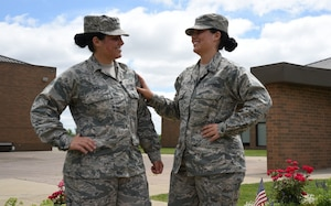 Lakota Hull, left, and Raven Hull pose for a photo at the 179th Airlift Wing in Mansfield, Ohio, July 25, 2017. Lakota and Raven are identical twins who enlisted in the Air Force National Guard together. Air Force photo by Airman 1st Class Christi Richter
