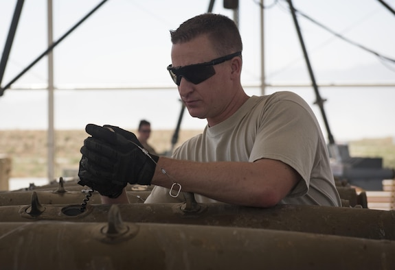 Tech. Sgt. Chris Brunsman, 455th Expeditionary Maintenance Squadron, installs an initiator into a general purpose bomb body at Bagram Airfield, Afghanistan, Aug. 4, 2017. Munitions systems Airmen are responsible for the accountability of everything from small arms ammunitions to large-scale guided bomb units. (U.S. Air Force photo by Staff Sgt. Benjamin Gonsier)