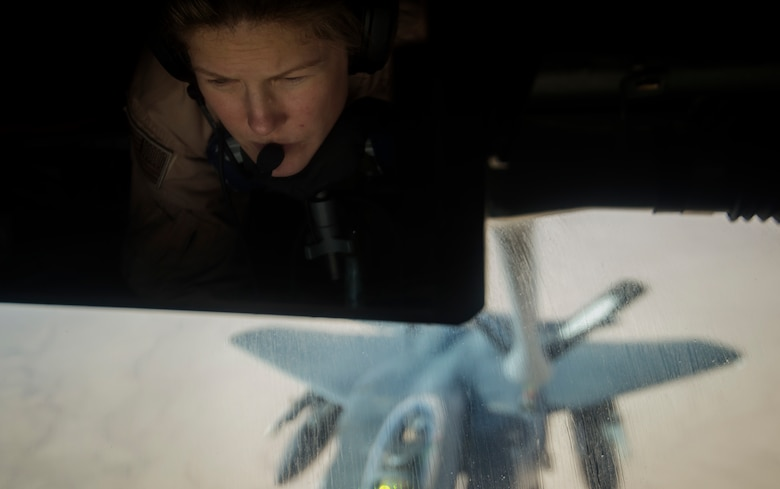 A boom operator, assigned to the 340th Expeditionary Air Refueling Squadron, refuels an F-15E Strike Eagle from a KC-135 Stratotanker above Southwest Asia, July 20, 2017. The KC-135 provides core refueling capabilities for Operation Inherent Resolve in the U.S. Central Command area of responsibility. (U.S. Air Force photo/Staff Sgt. Trevor T. McBride)