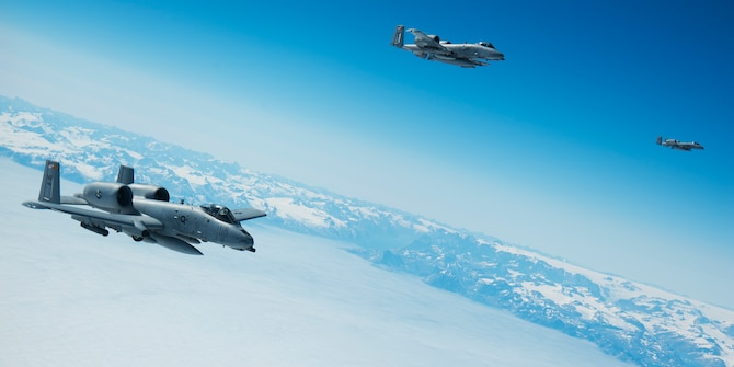 Three A-10C Thunderbolt IIs from the 175th Wing, Maryland Air National Guard, fly off the southern coast of Greenland while en route to Iceland Aug. 3, 2017. Two KC-135 Stratotankers and their crews from the 459th Air Refueling Wing embarked on a mission to provide refueling support to the 175th Wing as the ANG unit made its way to Estonia to participate in a state partnership program. (U.S. Air Force photo/Tech. Sgt. Kat Justen)