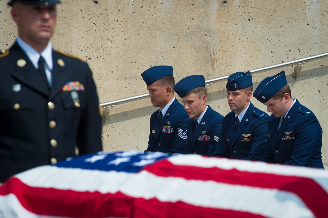 Airmen and soldiers pay their respects at the funeral of 2nd Lt. Charles E. Carlson at the Indiantown Gap National Cemetery in Annville, Pennsylvania Aug. 4, 2017. Nearly 50 Airmen assigned to the 62nd Fighter Squadron at Luke Air Force Base, Arizona attended the funeral. Carlson, then 24 years-old, was killed after his P-47 Thunderbolt was shot down by enemy aircraft near Bonn, Germany during World War II on Dec. 23, 1944. More than 70 years later his remains were identified and brought home. (U.S. Air Force photo/Staff Sgt. Jensen Stidham)
