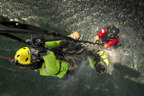 Pararescuemen from the 38th Rescue Squadron climb a ladder into an HH-60G Pave Hawk, Aug. 7, 2017, near Dog Island, Fla. Airmen from the 23d Wing and 325th Fighter Wing conducted daytime water rescue operations training in conjunction with exercise Stealth Guardian, which is designed to test aircrews with real-world exercise scenarios similar to a deployed or contingency environment. (U.S. Air Force photo/Staff Sgt. Ryan Callaghan)