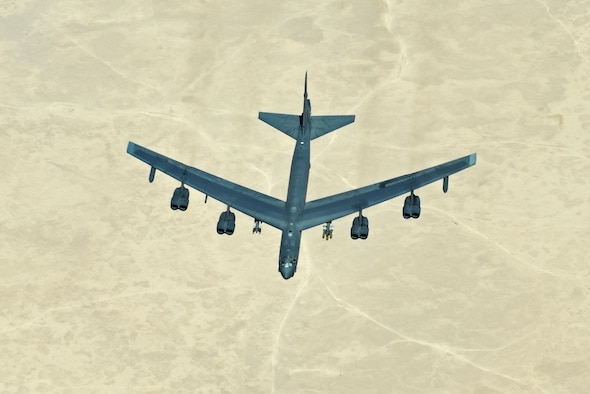 A B-52 Stratofortress waits to approach a 908th Expeditionary Air Refueling Squadron KC-10 Extender for refueling, Aug. 8, 2017. In a conventional conflict, the B-52 can perform strategic attack, close-air support, air interdiction, offensive counter-air and maritime operations. (U.S. Air Force photo/Staff Sgt. Marjorie A. Bowlden)