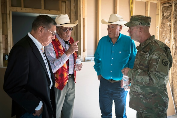U.S. Army Brig. Gen. Robert Sparing, the assistant adjutant general-Army for the Montana National Guard, talks with Crow tribal leaders in veteran home in Crow Agency, Mont., July 26, 2017. The Innovative Readiness Training program is a civil-military relations cooperative that provided hands-on training for military members who built and renovated homes for Crow military veterans. (U.S. Air National Guard photo by Tech. Sgt. Lealan Buehrer)