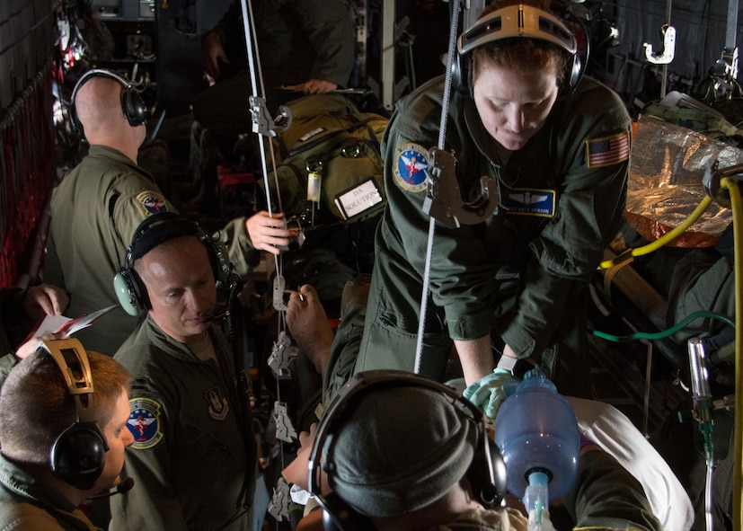 Tech. Sgt. Katherine Henson, 94th Aeromedical Evacuation Squadron flight medic, performs compressions on a medical-training dummy simulating cardiac arrest aboard a C-130H Hercules July 27, 2017. In addition to compressions, the medics also used a defibrillator to deliver electric currents to the patient's heart. (U.S. Air Force photo/Staff Sgt. Andrew Park)