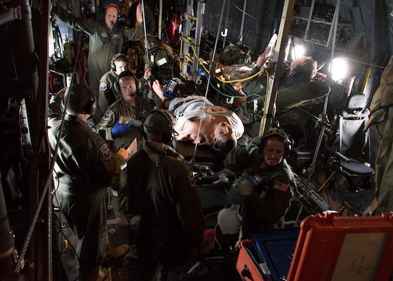 Members of the 94th Aeromedical Evacuation Squadron surround a medical-training dummy simulating cardiac arrest aboard a C-130H Hercules July 27, 2017. The nurses identified that the patient was pulseless, so they moved into performing CPR. (U.S. Air Force photo/Staff Sgt. Andrew Park)
