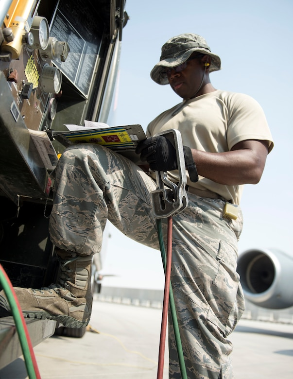 U.S Air Force Tech. Sgt. Jason Johnson, a fuels specialist with the 379th Expeditionary Logistics Readiness Squadron, Fuels Management Flight, records the fuel output at Al Udeid Air Base, Qatar, July 24, 2017.