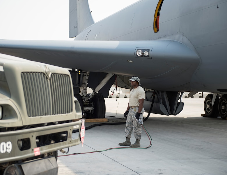 U.S Air Force Tech. Sgt. Jason Johnson, a fuels specialist with the 379th Expeditionary Logistics Readiness Squadron, Fuels Management Flight, monitors the fuel flow at Al Udeid Air Base, Qatar, July 24, 2017.