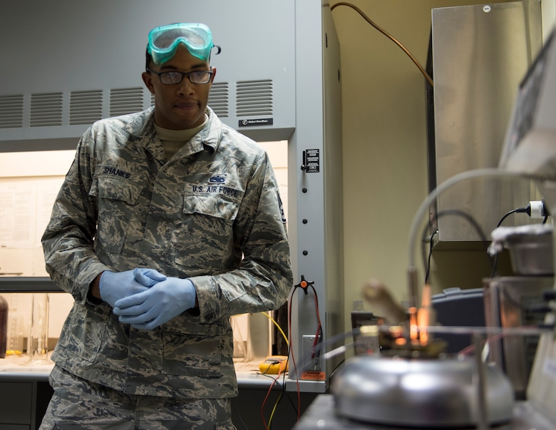 U.S Air Force Staff Sgt. Mario Shanks, non-commission officer in charge of the fuels lab with the 379th Expeditionary Logistics Readiness Squadron, Fuels Management Flight, watches the flash-point tester at Al Udeid Air Base, Qatar, July 24, 2017.