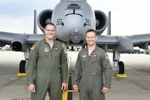 Capt. Brett DeVries (right) and his wingman Maj. Shannon Vickers, both A-10 Thunderbolt II pilots of the 107th Fighter Squadron from Selfridge Air National Guard Base, Mich.  Vickers helped DeVries safely make an emergency landing July 20 at the Alpena Combat Readiness Training Center after the A-10 DeVries was flying experienced a malfunction. (U.S. Air National Guard photo by Terry Atwell)