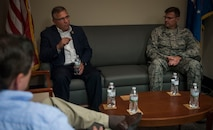 Congressman Mike Bost, representing the 12th district of Illinois, speaks with 932nd AW leadership during a scheduled visit Aug. 5, 2017, Scott Air Force Base, Illinois.  Bost learned about the 932nd AW and how the Air Force Reserve Command wing impacts the region. (U.S. Air Force photo by Tech. Sgt. Christopher Parr)