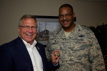 Congressman Mike Bost, representing the 12th district of Illinois, shows off the wing commanders's coin that Col. Esteban Ramirez, commander, 932nd Airlift Wing presented during Bost's visit Aug. 5, 2017, Scott Air Force Base, Illinois.   (U.S. Air Force photo by Tech. Sgt. Christopher Parr)