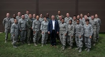 Congressman Mike Bost enjoys a quick group photo before having a open discussion luncheon with Airmen from the 932nd Airlift Wing, Aug. 5, 2017, Scott Air Force Base, Illinois. Bost visited various work areas within the 932nd AW.  He spent time with Airmen learning about the medical component, civil engineers and the DV mission and the people that make it all happen.  (U.S. Air Force photo by Tech. Sgt. Christopher Parr)