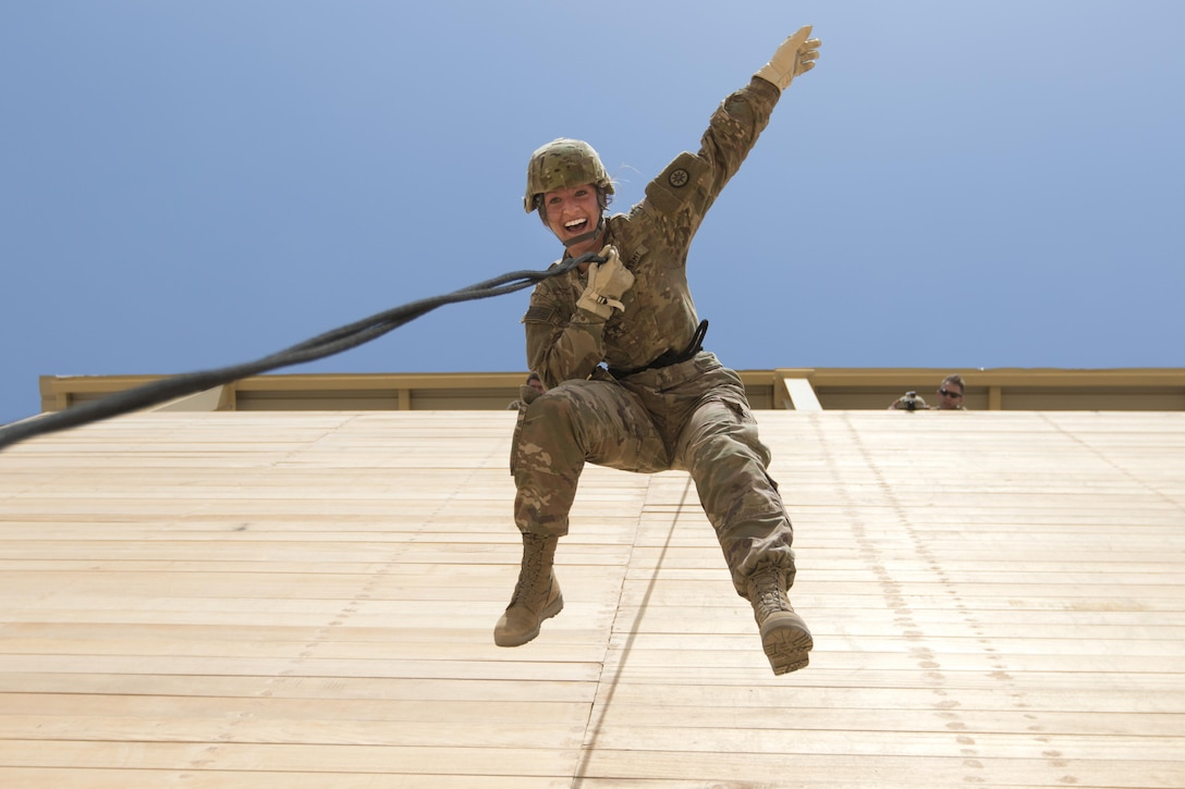 """Sgt. Stefania Young, a U.S. Army Reserve Soldier with the 316th Sustainment Command (Expeditionary), based out of Coraopolis, Pa., currently deployed to the U.S. Central Command, rap """"aussie"""" rappels off of a tower during a professional development training at Camp Buehring, Kuwait, on July 31, 2017. (U.S. Army photo by Spc. Chevele Crawford)"""