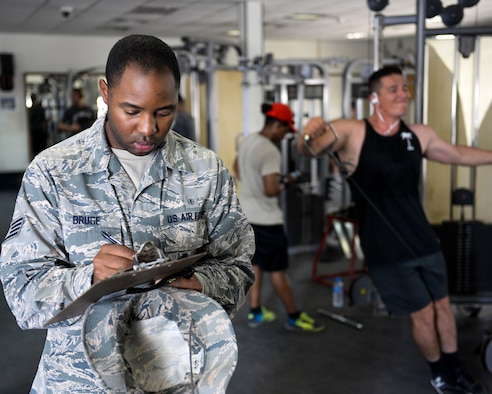 U.S. Air Force Staff Sgt. Kartae Bruce, non-commissioned officer in charge of force health management assigned to the Public Health Element of the 379th Expeditionary Medical Group, conducts an inspection of the gym at Al Udeid, Air Base, Qatar, July 26, 2017. The members of the 379th EMDG/SGOL work behind the scenes to help keep Airmen deployed here healthy by inspecting public facilities, ensuring the medical readiness of forward deploying Airmen and by tracking and working to prevent the spread of communicable diseases. (U.S. Air National Guard photo by Tech. Sgt. Bradly A. Schneider/Released)