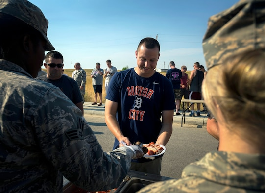 U.S. Air Force Senior Airman Derek Elsey, a water and fuel systems maintenance specialist with the 182nd Civil Engineer Squadron, Illinois Air National Guard, gets manicotti and meatballs for dinner in Crow Agency, Mont., Aug. 1, 2017. Force Support Squadron services specialists provided meal support to the squadron's unit members while they built veterans' homes for the Innovative Readiness Training program. (U.S. Air National Guard photo by Tech. Sgt. Lealan Buehrer)
