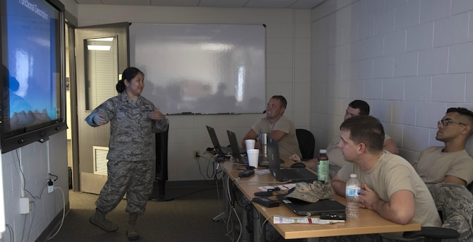U.S. Air Force Tech. Sgt. Erica Northam, a communications, navigation, and mission systems instructor assigned to the 373rd Training Squadron, Detachment 2, instructs a Block 45 training course to Airmen at MacDill Air Force Base, Fla., August 8, 2017. This class offers avionics technicians a chance to get hands-on experience with the Block 45 program that is replacing old analog systems on the KC-135 Stratotanker aircraft. (U.S. Air Force photo by Airman 1st Class Ashley Perdue)