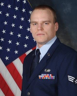 (Then) Senior Airman Dustin Haucke poses for a photo to be used to compete for the National Air and Space Intelligence Center's annual award. Now a staff sergeant, Haucke was named the Air Force's Force Support Airman of the Year at the operational level for 2016. (Courtesy photo)