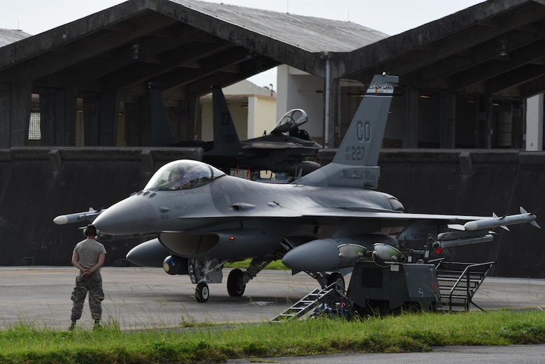 An F-16 aircraft on the flight line preparing to take off.