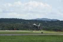 An F-16 Fighting Falcon aircraft takes off from Kadena Air Base, Japan during a Theater Security Package deployment. About 250 members of the 140th Wing spent three months in Japan in order to strengthen relationships and train with other deployed U.S. military and allied forces in the region. (Photo by Staff Sgt. Bobbie Reynolds)
