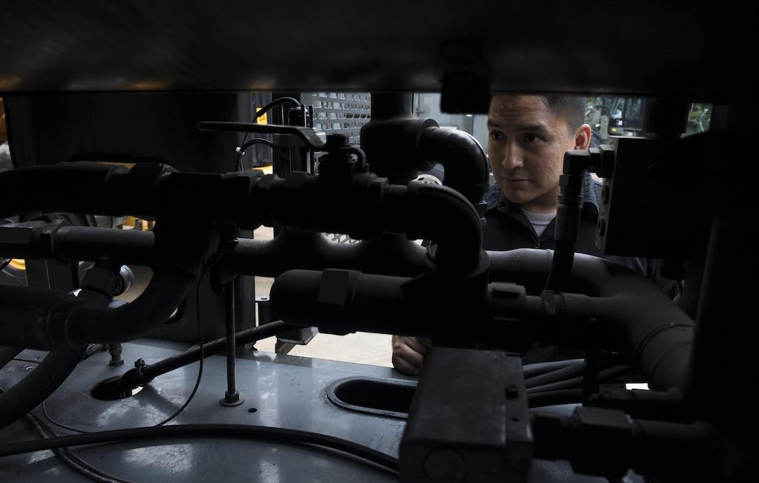U.S. Air Force Senior Airman Joey James, 86th Vehicle Readiness Squadron Special Purpose maintenance technician, inspects the inner workings of a standard deicing truck for the squadron's Summer Rebuild Program on Ramstein Air Base, Germany, Aug. 8, 2017. The 86th VRS inspects and repairs all snow removal vehicles on Ramstein every summer during the rebuild program to ensure they are fully operational for the winter months. (U.S. Air Force photo by Senior Airman Tryphena Mayhugh)