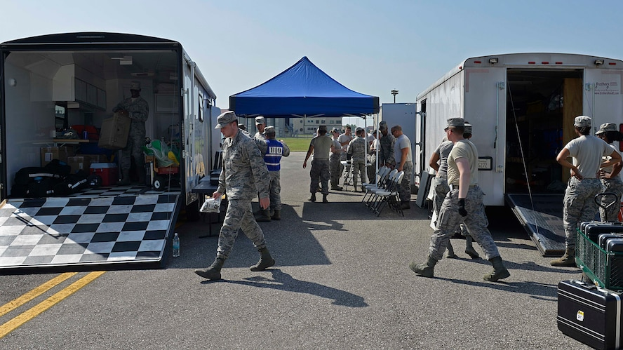 Airmen from the 31st Aerospace Medical Squadron bioenvironmental engineer flight teamed with the 31st Civil Engineer Squadron emergency management flight, to set up decontamination stations during a staged emergency scenario Aug. 3, 2017, at Aviano Air Base, Italy. The 31st Fighter Wing conducted a week-long readiness inspection July 31 through Aug. 4, 2017, at Aviano Air Base, Italy, to test the wing's readiness and emergency response capabilities. (U.S. Air Force photo by Senior Airman Cary Smith)