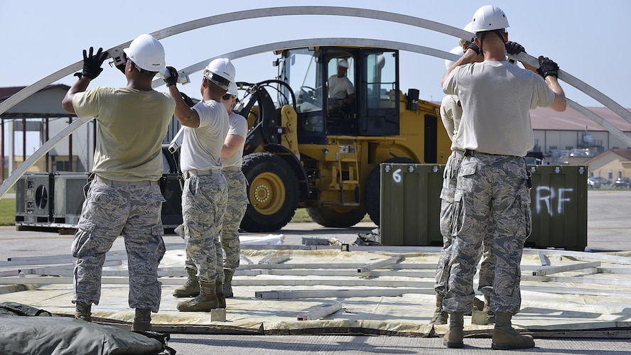 Airmen from the 31st Civil Engineer Squadron build a tent during a staged emergency scenario Aug. 3, 2017, at Aviano Air Base, Italy. The 31st Fighter Wing conducted a week-long readiness inspection July 31 through Aug. 4, 2017, at Aviano Air Base, Italy, to test the wing's readiness and emergency response capabilities. (U.S. Air Force photo by Senior Airman Cary Smith)