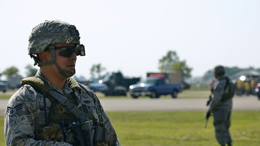 Senior Airman Elias Maldonado, 31st Security Forces Squadron defender, provides security during a staged emergency scenario Aug. 3, 2017, at Aviano Air Base, Italy. The 31st Fighter Wing conducted a week-long readiness inspection July 31 through Aug. 4, 2017, at Aviano Air Base, Italy, to test the wing's readiness and emergency response capabilities. (U.S. Air Force photo by Senior Airman Cary Smith)