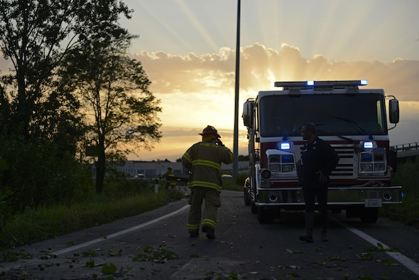 Fabrizio La Marca, 31st Civil Engineer Squadron crew chief, assists in clearing debris off a highway Aug. 10, 2017, in Pordenone Province, Italy. The 31st CES firefighters teamed with local first responders to clear roadways after heavy thunderstorms passed through the area. (U.S. Air Force photo by Tech. Sgt. Andrew Satran)