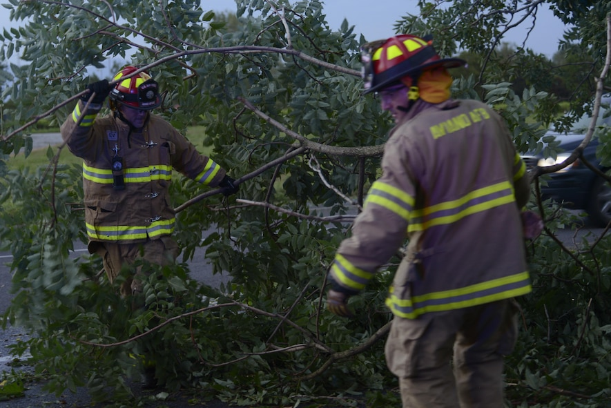 Tech. Sgt. Brian Martenis and Fabrizio La Marca, 31st Civil Engineer Squadron firefighters, remove a tree from a highway Aug. 10, 2017 in Pordenone Province, Italy. The 31st CES firefighters teamed with local first responders to clear roadways after heavy thunderstorms passed through the area. (U.S. Air Force photo by Tech. Sgt. Andrew Satran)