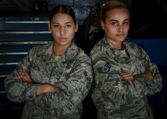 U.S. Air Force Staff Sgt. Ashlery Boyer, a structural maintenance technician assigned to the 927th Maintenance Squadron (MXS), poses with Airman 1st Class Katherine Dawson, metals technologies apprentice assigned to the 6th MXS, at MacDill Air Force Base, Fla., Aug. 4, 2017. The 6th MXS works hand-in-hand with the 927th MXS, to manufacture parts and maintain the 12 KC-135 Stratotanker aircraft assigned to the base. (U.S. Air Force Photo by Staff Sgt. Adam C. Borgman)