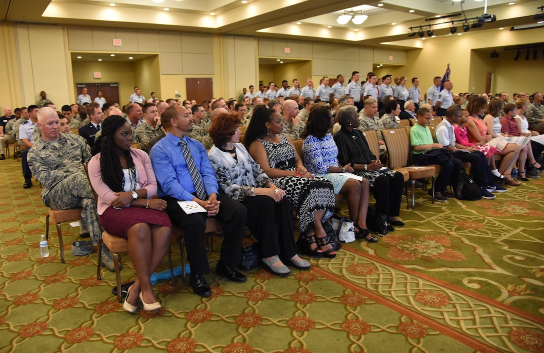 Keesler personnel, families and friends attend the 81st Training Group change of command ceremony in the Bay Breeze Event Center Aug. 4, 2017, on Keesler Air Force Base, Miss. The ceremony is a symbol of command being exchanged from one commander to the next by the hand off of a ceremonial guidon. Col. Scott Solomon passed on command of the 81st TRG to Col. Leo Lawson, Jr. (U.S. Air Force photo by Kemberly Groue)